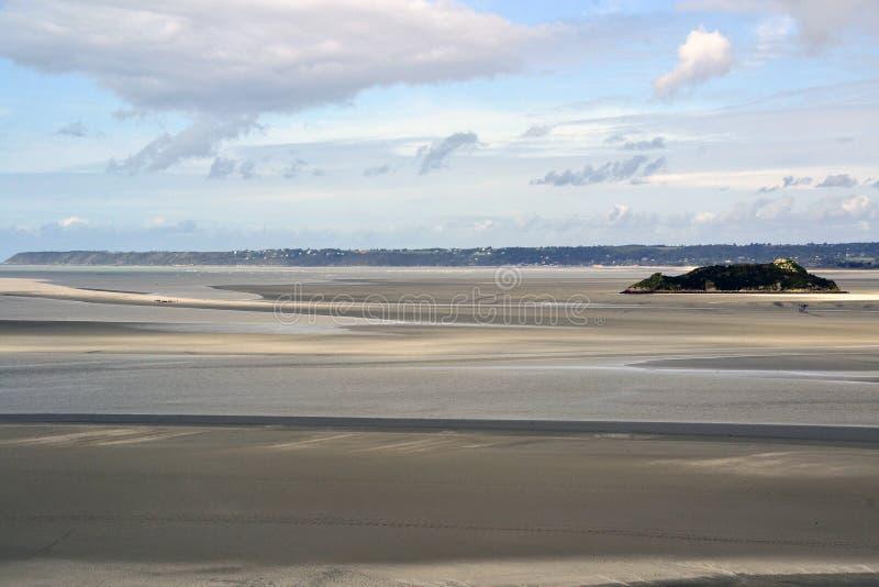Sand, island, sky, clouds stock photo