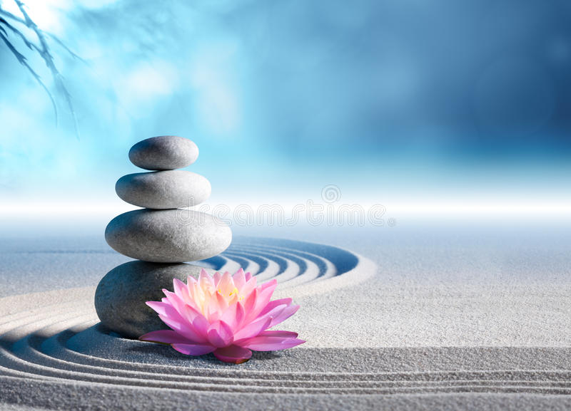 Sand, lily and spa stones. In zen garden