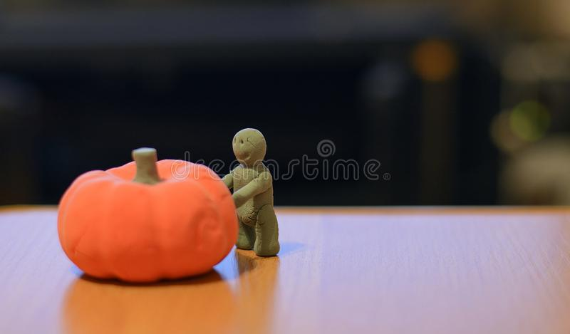 Sand man dragging a pumpkin into halloween. 2017 royalty free stock images