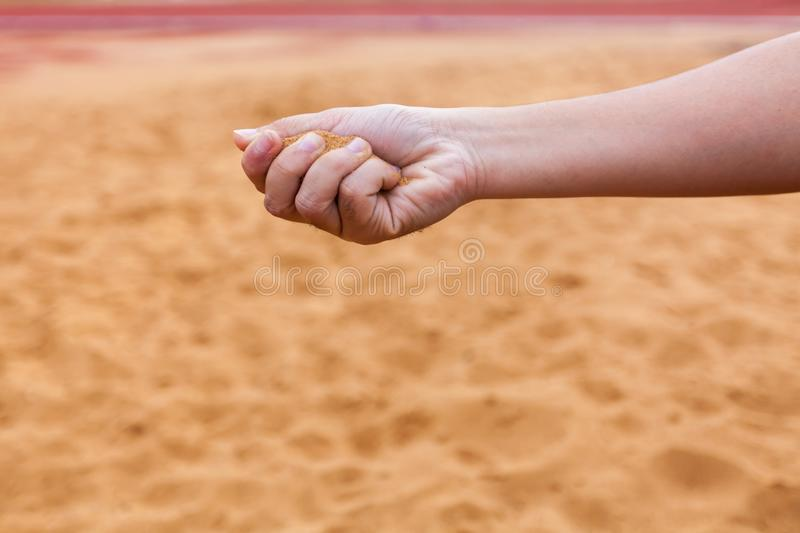 Sand in man`s hand blur background select focus. Sand in man`s hand blur background select focus royalty free stock photo