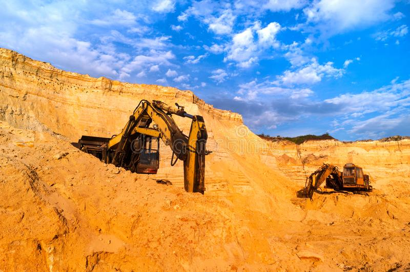 Sand mining concept.Track-type loader excavator with heavy machinery. Construction industry. Old rusty bulldozer machine royalty free stock photo