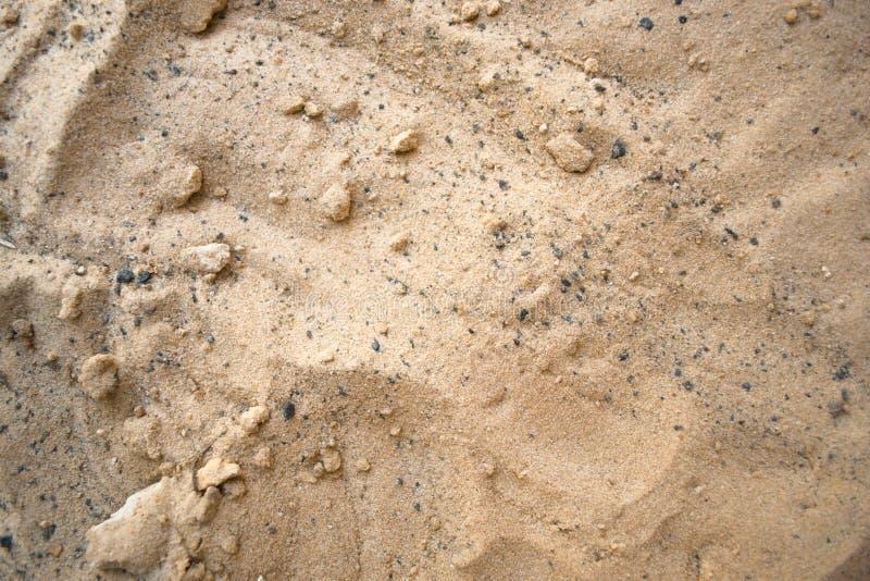 Sand på ett soligt strandbegrepp för sommar royaltyfri foto
