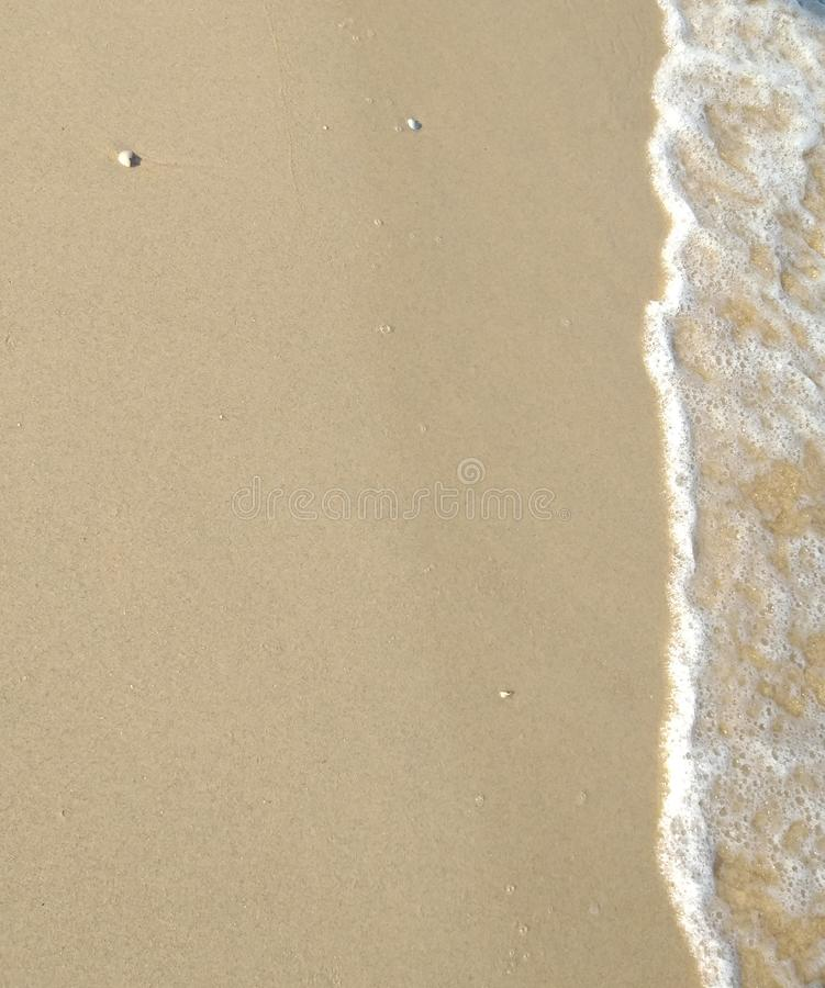 Sand på kusten, havsbakgrund royaltyfri bild