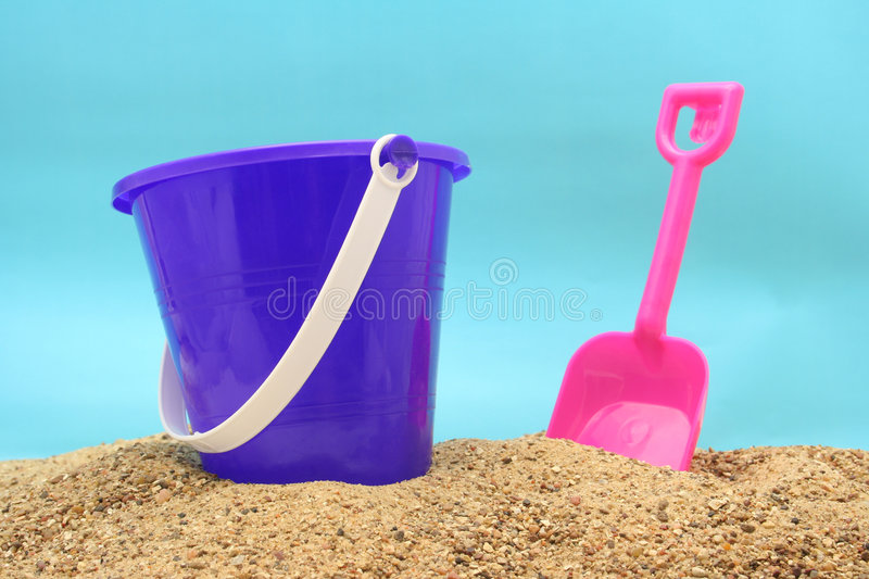 Sand Pail. With Pink Shovel at Beach royalty free stock images