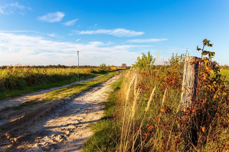 Sand path near Wiesmoor in East Frisia. A sandy path near Wiesmoor in the east frisian countryside royalty free stock photos
