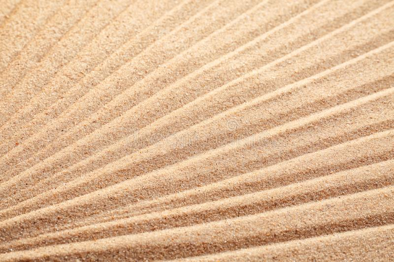 Sand with pattern, closeup royalty free stock photography