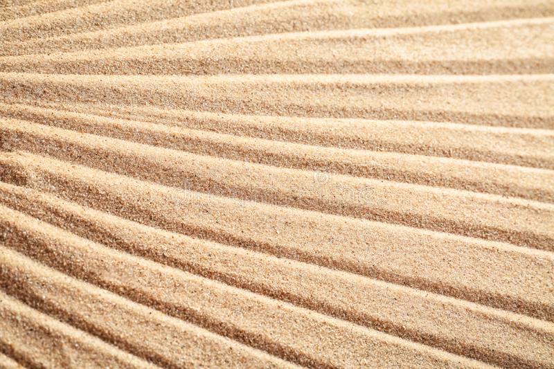 Sand with pattern, closeup royalty free stock photos