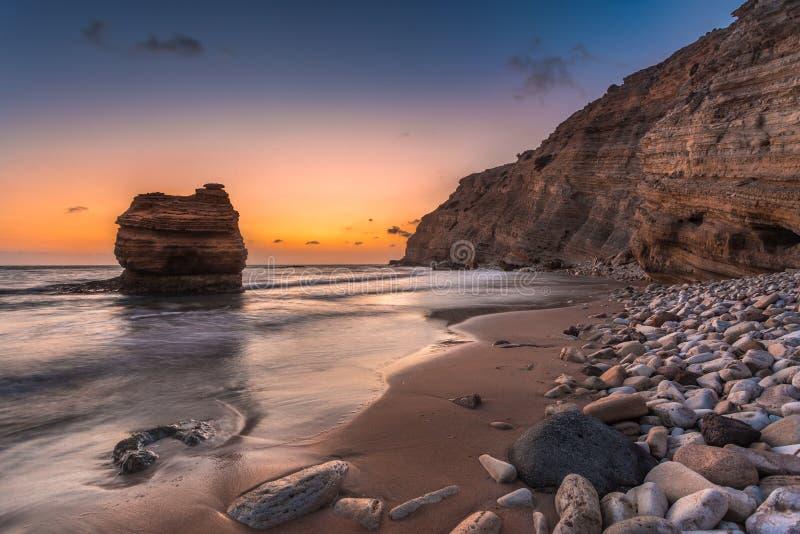Sand and Pebble beach at Cavo Paradiso in Kefalos, Kos island, Greece. stock photography
