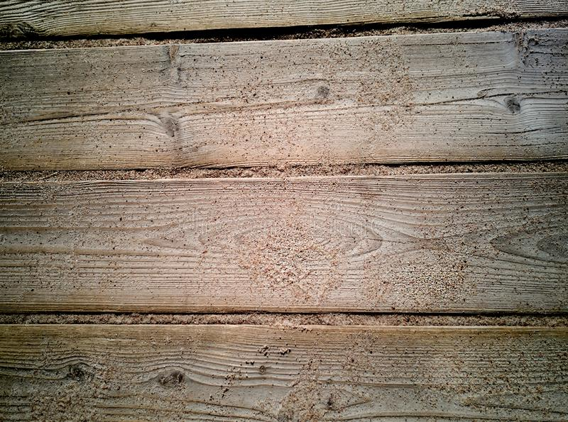 Sand on planked wood. Summer background with copy space. Top view stock photo