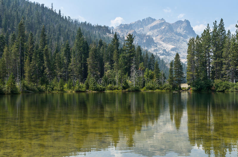 Sand Pond and the Sierra Buttes. The Sierra Buttes overlook Sand Pond in the Lakes Basin royalty free stock photography