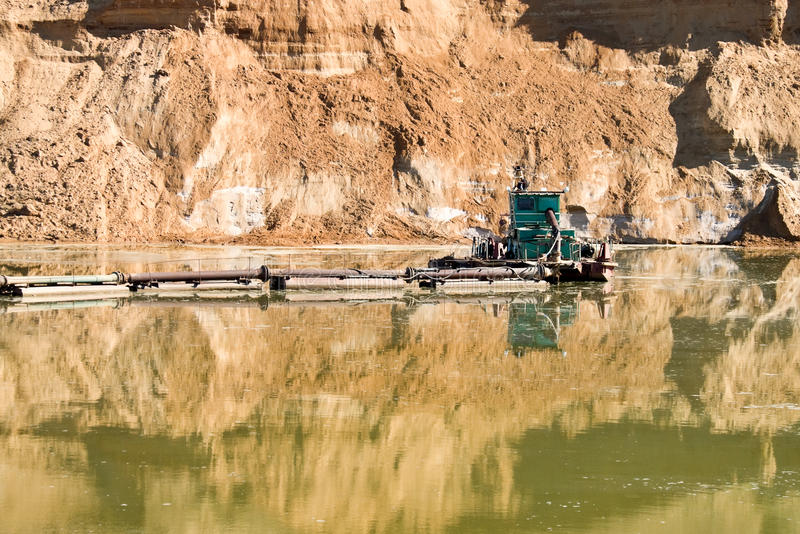 Sand quarry, sand-wash. Construction of sand from the rocking days of the lake royalty free stock photo