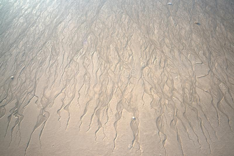 Sand rippled textured pattern and background created by low tide. royalty free stock photography