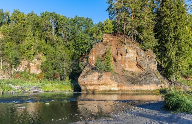 Sand rocks zvartes red rocks on Amata river, Latvia royalty free stock image