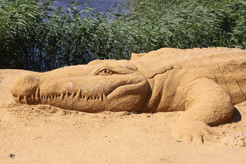 Sand sculpture alligator stock photo