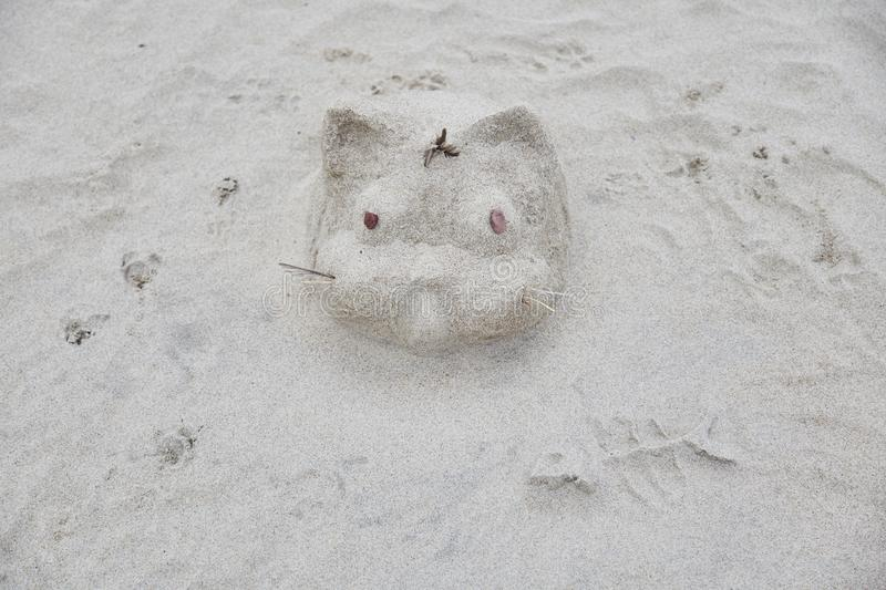 Sand sculpture of a cat on the beach.  stock images