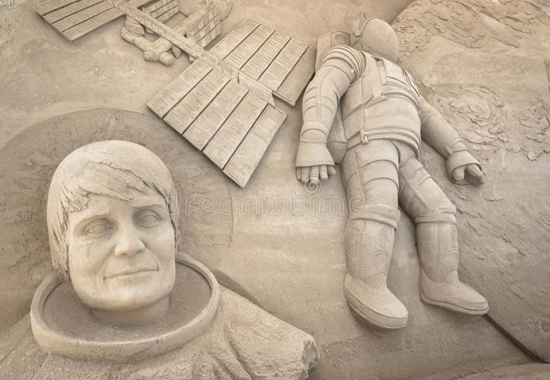 Sand sculpture depicting the first moon landing. It can be used as background royalty free stock photo