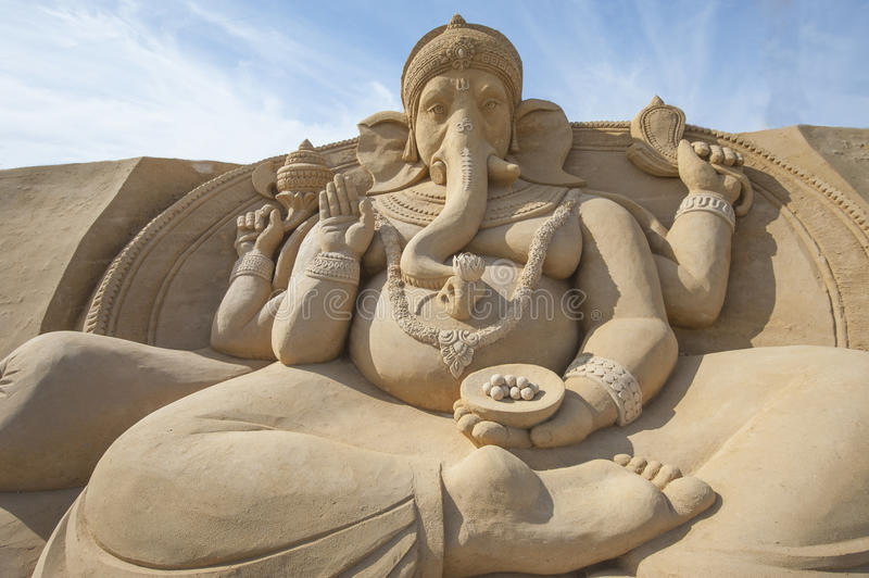 Sand sculpture of Hindu god Ganesh. Large sand sculpture of the Hindu god Ganesh at sand city theme park stock photo