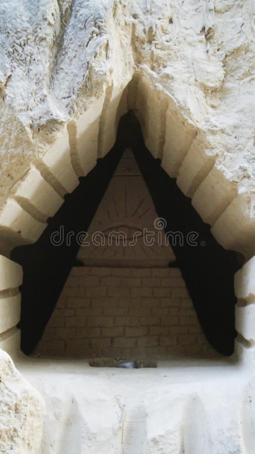 Sand sculpture of a pyramid, art royalty free stock images