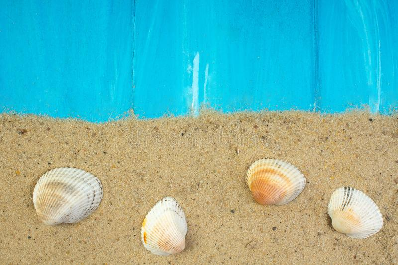 Sand, seashells, stones on blue background. Concept of rest. Top view. stock photos
