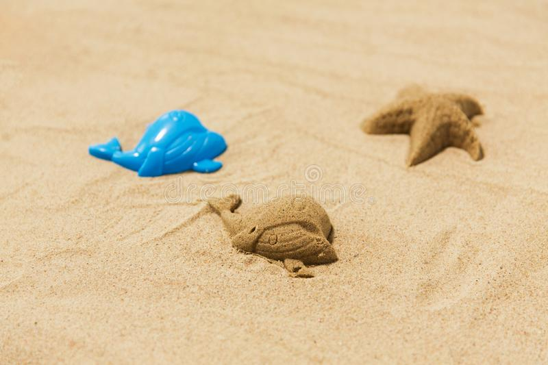 Sand shape made by whale mold on summer beach royalty free stock image