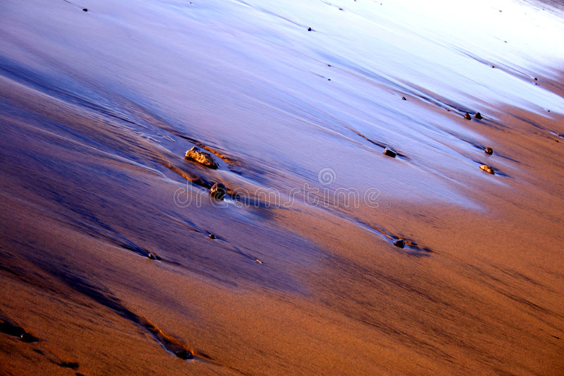 Sand Sheen. Beach with sheen, pebbles and sand royalty free stock image
