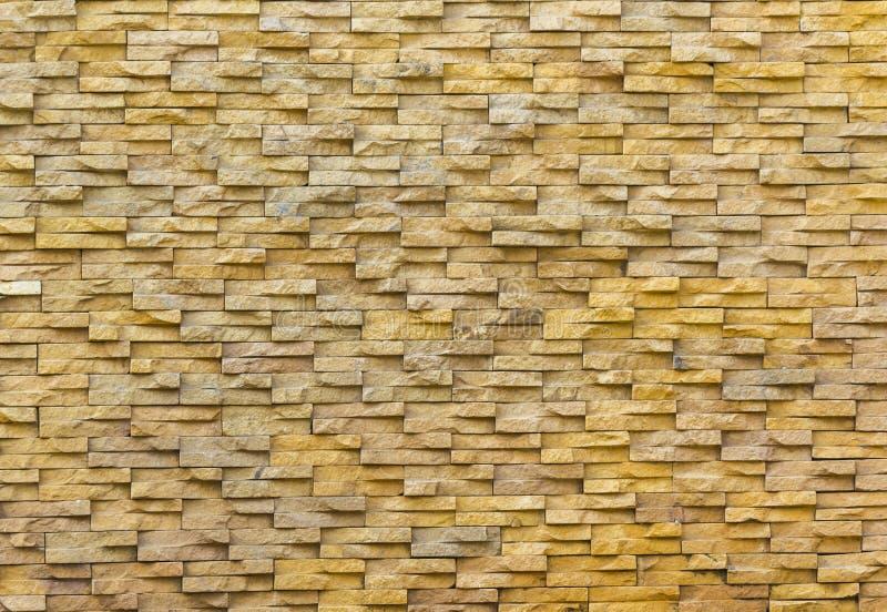 Sand stone brick wall. Closeup detail of sand stone brick wall royalty free stock images