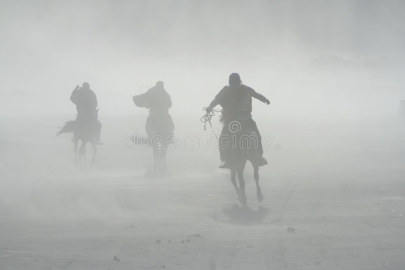 Sand storm horse riders mount bromo stock images