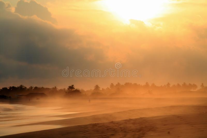 Sand Storm over Pacific Ocean Sandy Beach at Sunset royalty free stock photos
