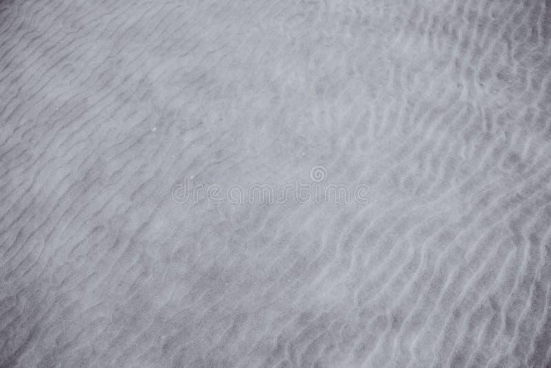 Sand- und Wasserhintergrundbeschaffenheit, abstrakt lizenzfreie stockfotos