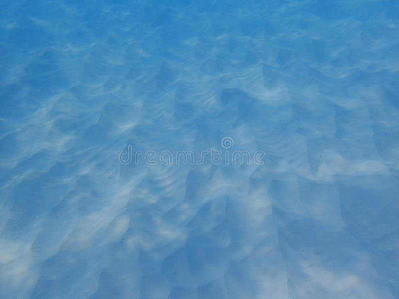 Sand underwater that the waves have formed a pattern that is unique, abstract artistic lines. Sand underwater photography that the waves have formed a pattern stock photo