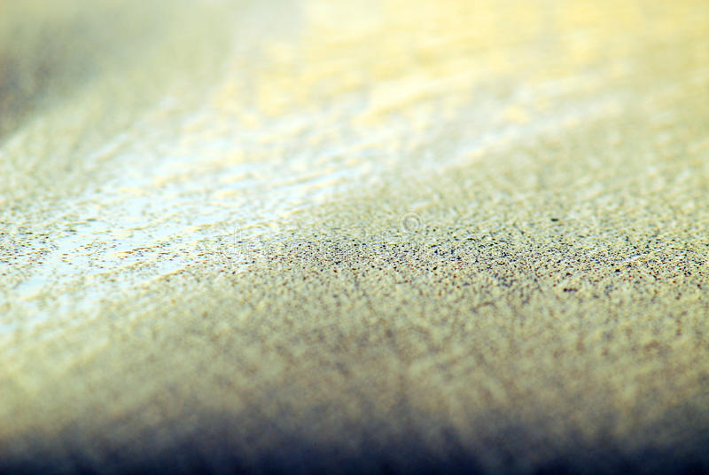 Sand, vatten och ljus arkivbild