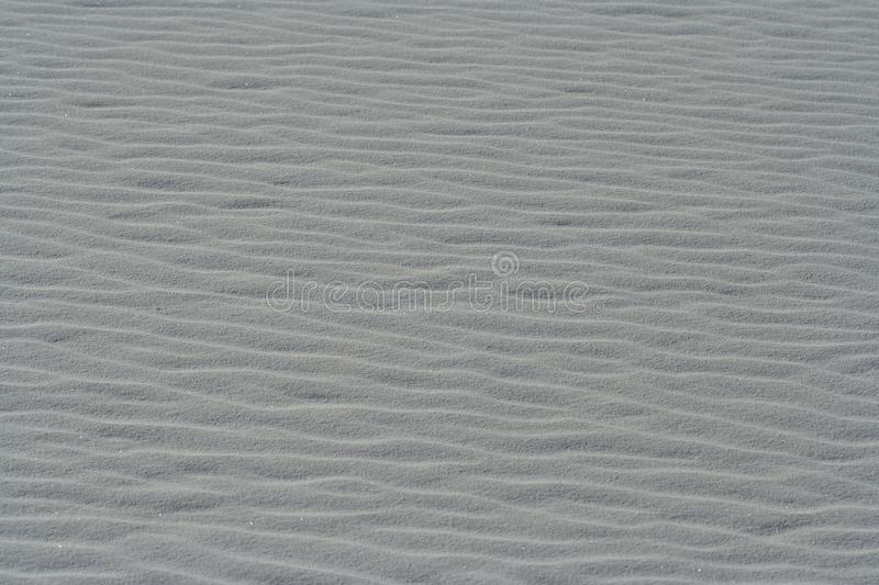 Sand wave pattern on  sand dunes at White Sands National Park, New Mexico, won. Glittering white sand dunes at White Sands National Park in New Mexico are made stock image