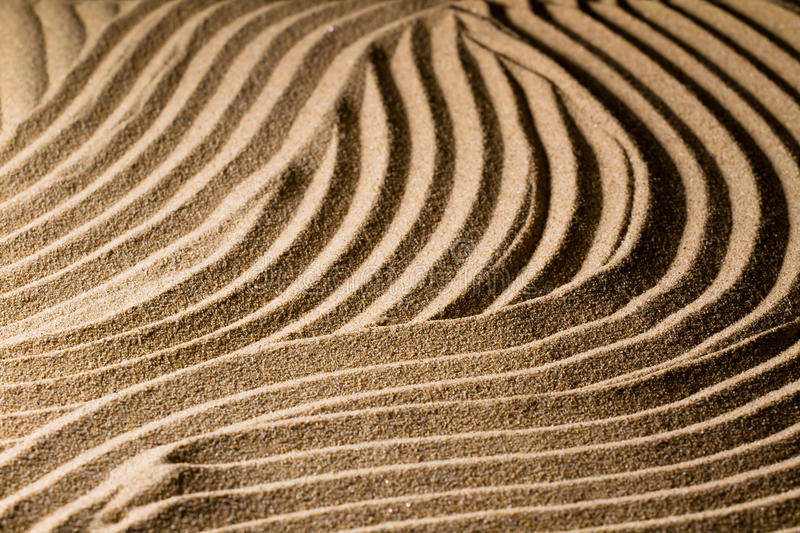 Sand Wave. Ripples in the sand. Sand patterns stock photos
