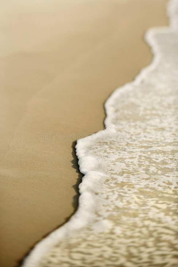 Sand with waves. royalty free stock photography