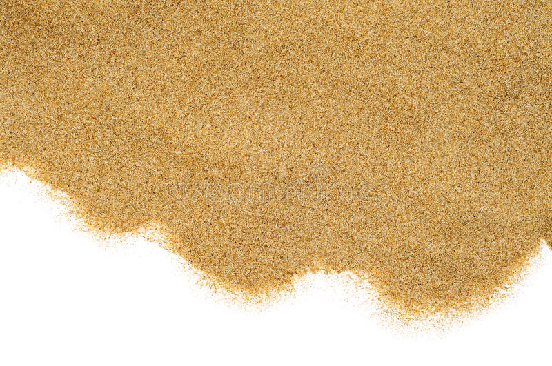 Sand on a white background. Closeup of a pile of sand of a beach or a desert, on a white background royalty free stock photography