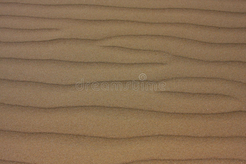 Sand and wind texture pattern. Patterns created from the wind in sand stock photos