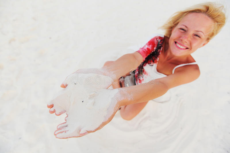 Download Sand in woman hands stock photo. Image of beach, loose - 23354436