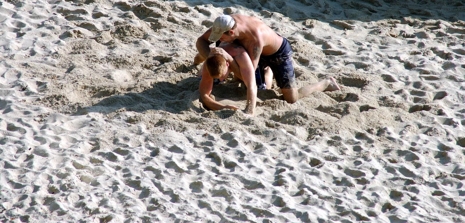 Sand Wrestlers. 2 men wrestling in the sand on a California beach stock photography
