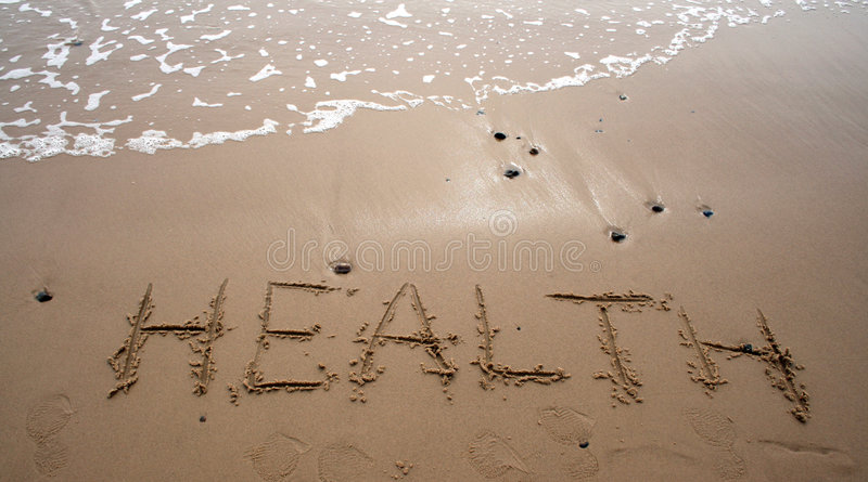 Sand writing - HEALTH royalty free stock photography