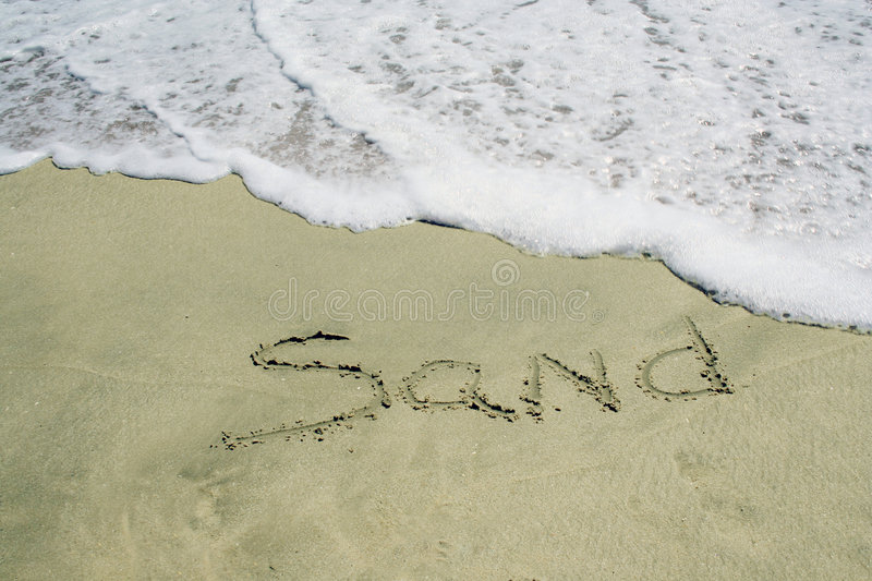 Sand written on beach stock images
