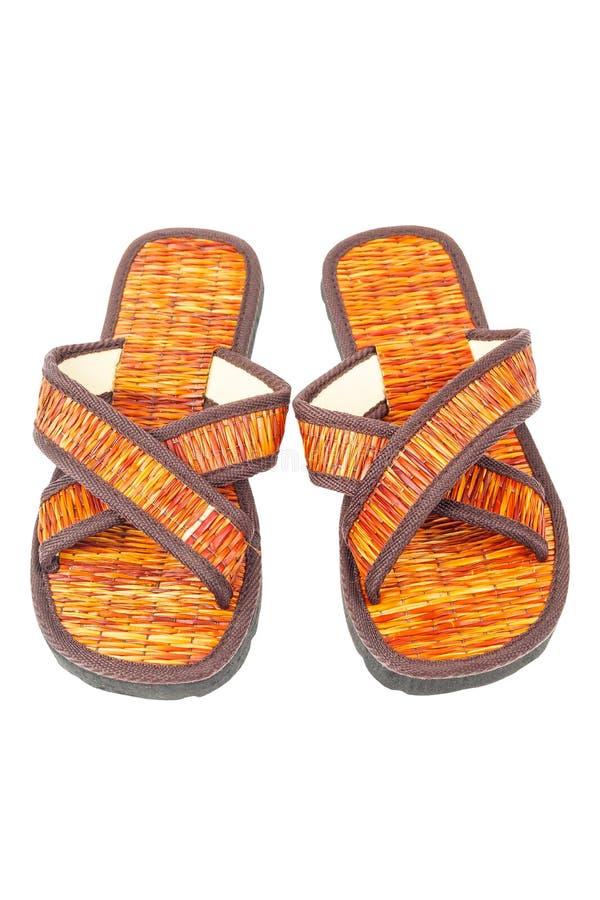 Sandaler för Flipmisslyckande sätter på land skor på vit bakgrund arkivfoton