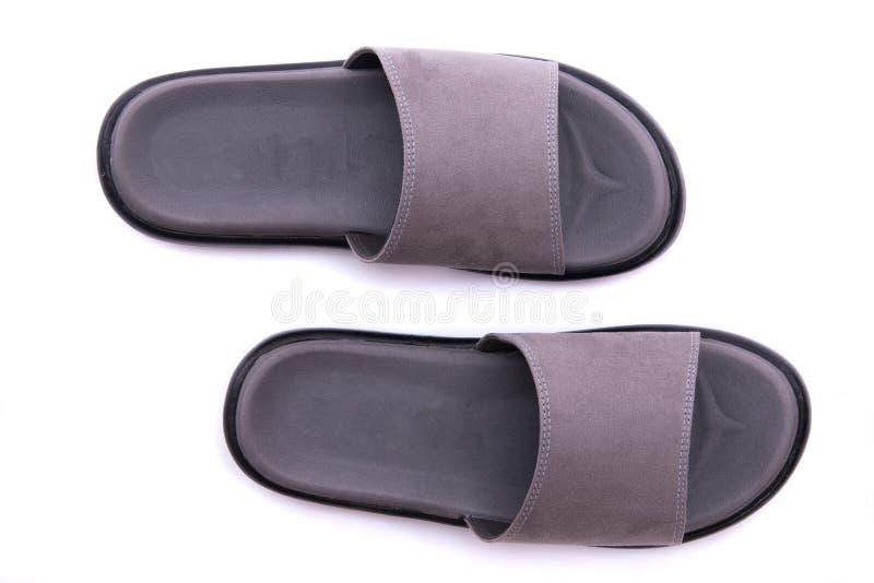 Sandalia de cuero gris imagenes de archivo
