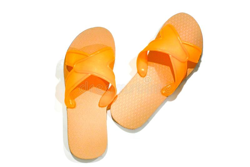 Sandalias anaranjadas en pares fotografía de archivo