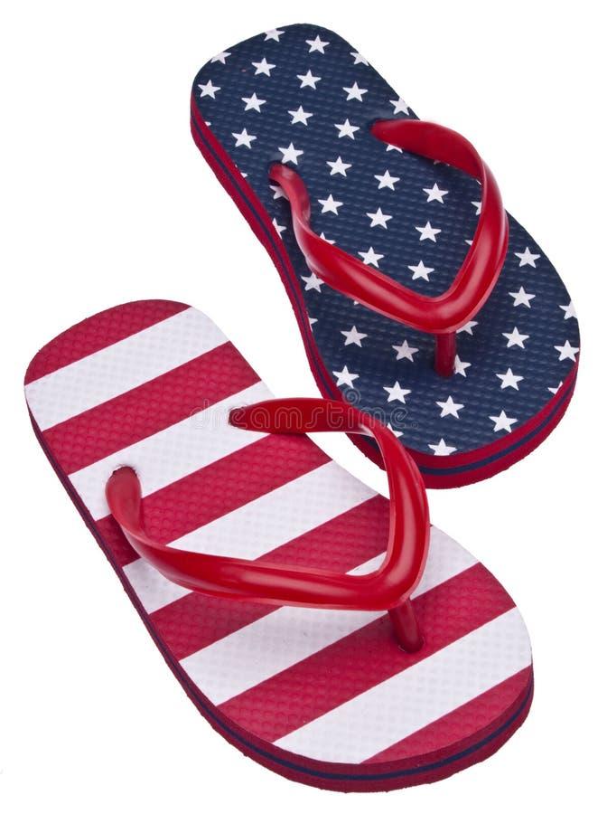 Sandalias blancas y azules rojas patrióticas del fracaso de tirón fotografía de archivo libre de regalías