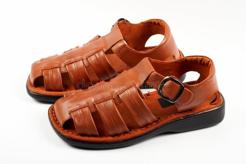 Sandalias de cuero de Brown imagenes de archivo