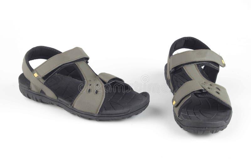Sandalias de cuero grises fotos de archivo
