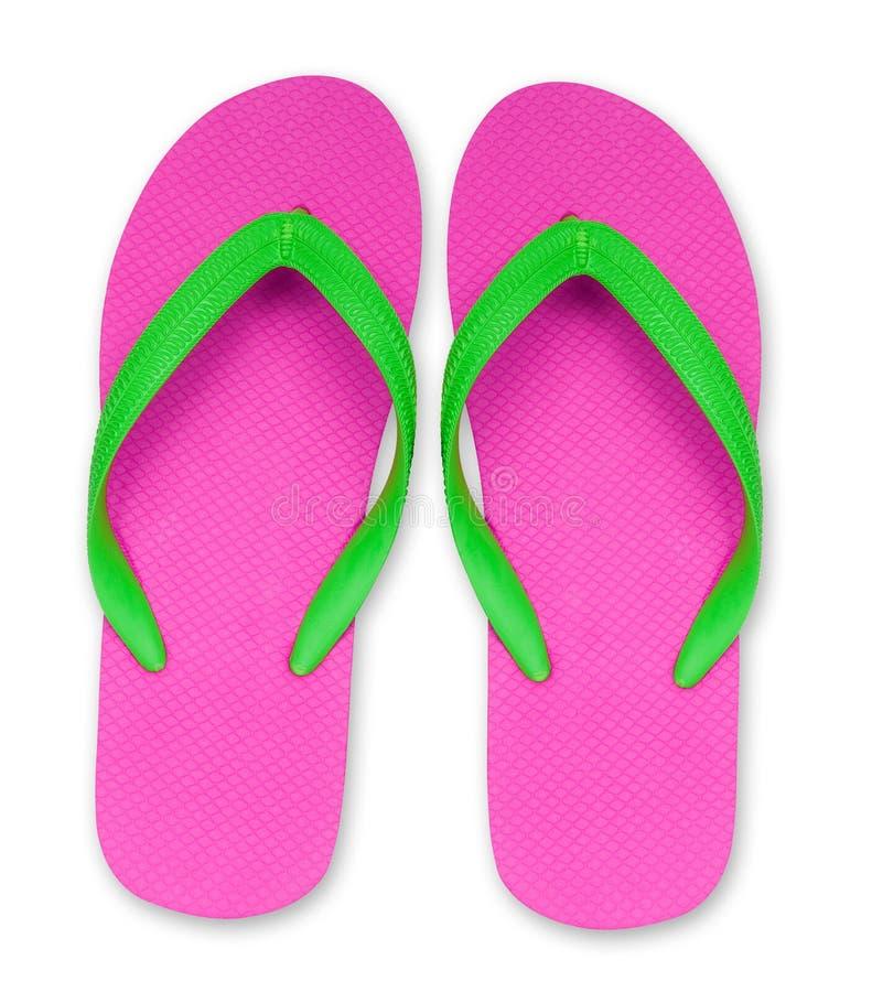 Sandalias rosadas y verdes del fracaso de tirón aisladas imagen de archivo