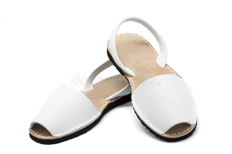 Sandals. A pair of white sandals over white background royalty free stock image