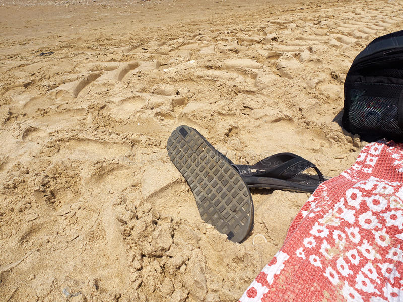 Sandals flip-flop on the beach. Summer vacation leisure image royalty free stock photography