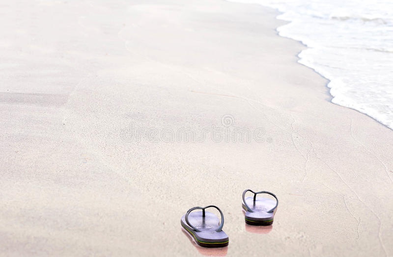 Sandals flip flops on the beach. Sandals flip flops in the tropical beach royalty free stock photos